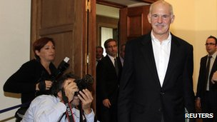 Greek PM George Papandreou leaves the cabinet meeting in Athens on 8 November 2011