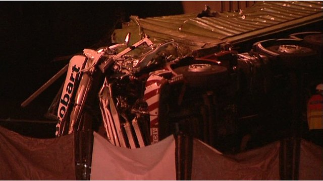 The wreckage of a lorry which fell onto the M56