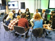 Members of youth forum sitting in a discussion group