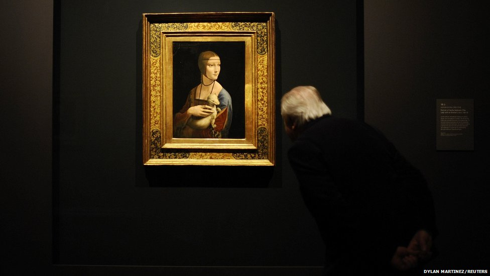 "A man takes a close look at a painting by Leonardo da Vinci entitled ""Portrait of Cecilia Gallerani"", (The Lady with an Ermine)"
