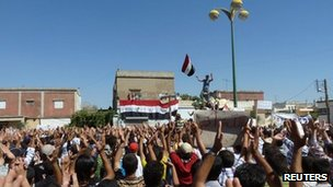 Demonstrators protesting against Syria's President Bashar al-Assad gather in Hula, near Homs, 4 November 2011
