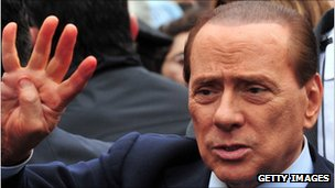 Silvio Berlusconi outside a Milan courthouse in 2011