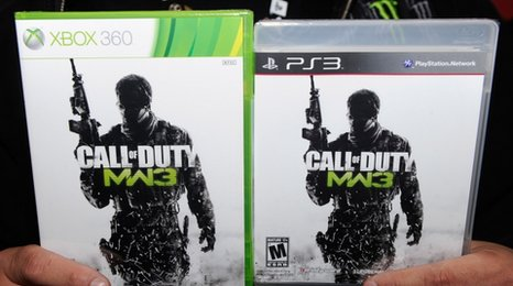 A shopper holds two copies of CoD: MW3