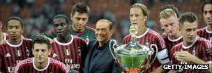 AC Milan chairman Silvio Berlusconi celebrates with players after winning the Berlusconi Trophy in 2011