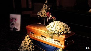 The golden coffin of Sir Jimmy Savile inside the Queens Hotel in Leeds