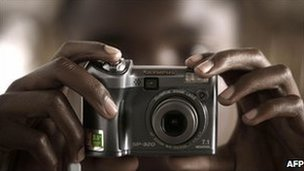 A person in Goma in the eastern Democratic Republic of Congo holding a camera