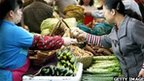 Lady buying vegetables at a market