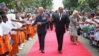 The Prince of Wales and the Duchess of Cornwall greet school children accompanied by Jakaya Kikwete, President of Tanzania