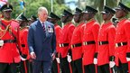 The Prince of Wales inspects the guard of honour during a parade in Dar es Salaam, Tanzania
