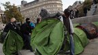 A breakaway group of protesters begin to set up tents in Trafalgar Square