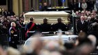 Marines lift Sir Jimmy's coffin