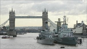 HMS Belfast (right) moored on the River Thames