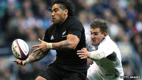 New Zealand's Centre Ma'a Nonu is tackled by England's Fly Half Toby Flood