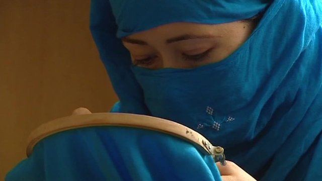 An Afghan woman embroidering