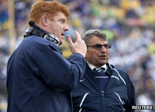 Penn State head coach Joe Paterno (R) talks with assistant coach Mike McQueary  (L)