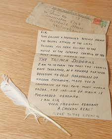 White feather and letter