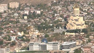 The presidential palace in Tbilisi on the left and the cathedral Mr Ivanishvili paid for on the right