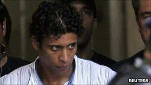 Antonio Francisco Bonfim Lopes escorted by police after his arrest in November 2011