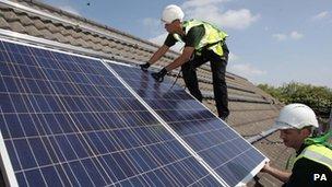 Workmen installing solar panels