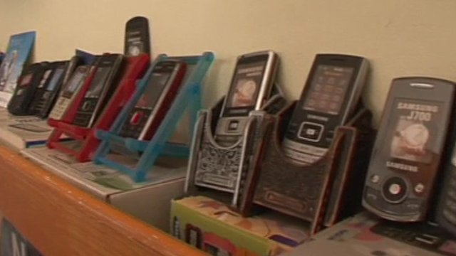Mobile phones on display in a shop in Mumbai