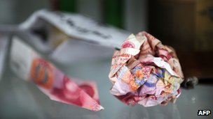 Balled up yuan notes thrown into Ai Weiwei's compound displayed at his studio on 9 November 2011