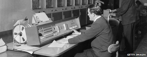 A computer programmer uses English Electric's super computer Leo III