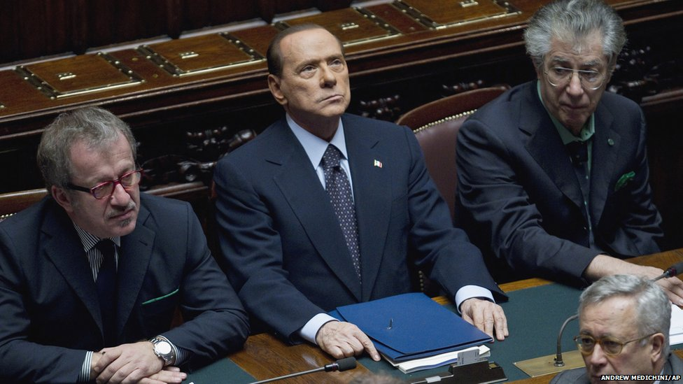 Silvio Berlusconi (centre) flanked by Interior Minister Roberto Maroni (left) and Reforms Minister Umberto Bossi during a voting session at the Lower Chamber, in Rome, 8 November