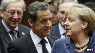 From left: Jean Claude Juncker, Nicolas Sarkozy and Angela Merkel