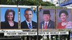 Posters showing the US and Indonesia presidents and their wives, in Jakarta on 9 November 2010