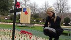 Kirianne Curley looks at the wooden crosses in the Field of Remembrance in Royal Wootten Bassett
