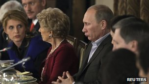 Russia's Prime Minister Vladimir Putin (centre) and guests near Moscow 11 November 2011