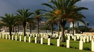 Graves in front of palm trees