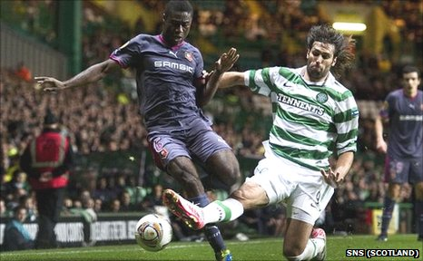 Celtic's Georgios Samaras slides in on Alexander Tettey of Rennes