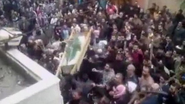 Protesters carrying coffin in Homs, Syria