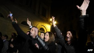 Protesters outside Palazzo Grazzioli in Rome, 12 November 2011