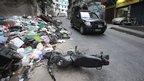 Policemen patrol Rocinha slum in Rio de Janeiro on 13 November 2011