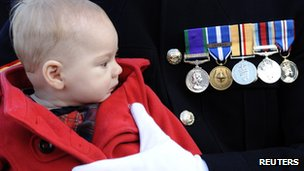 Murren Lawton held by father Royal Marine Corparal Shane Lawton, at a service in Fort William, Scotland