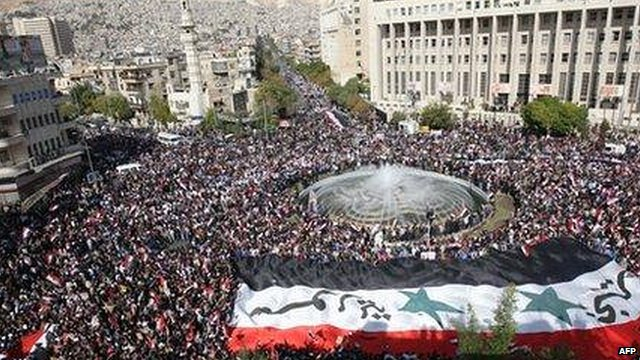 Thousands attend a rally in support of Syrian President Bashar al-Assad in Damascus, 13 November