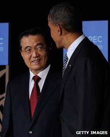 US President Barack Obama talks with Chinese President Hu Jintao at the Apec summit on 12 November 2011