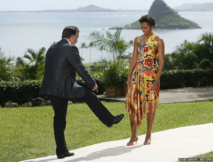 Tim Mathieson of Australia shows US First Lady Michelle Obama his cowboy boots