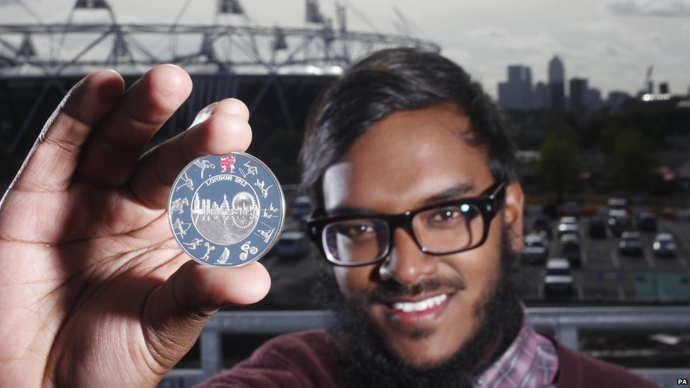 Saiman Miah, an architectural student from Birmingham poses with his winning design for the official London 2012 Olympic £5 coin.