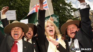 Actress and Gurkha campaigner Joanna Lumley celebrates with retired Gurkha soldiers adjacent to the Houses of Parliament on May 21 2009 in London.