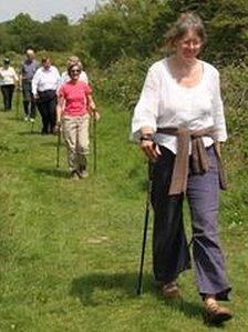 People walking in Coed Geufron near Aberystwyth
