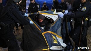 Police arrest a man in a tent in Oakland, California, 14 November 2011