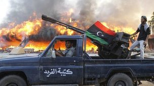 Libyan rebels in vehicle celebrate