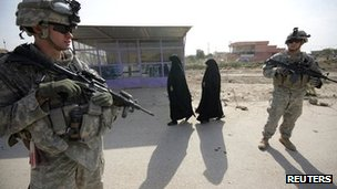 US soldiers stand guard during the distribution of medical aid and supplies to the Imam Ali Hospital in Jibella, south of Baghdad, on 12 November 2011