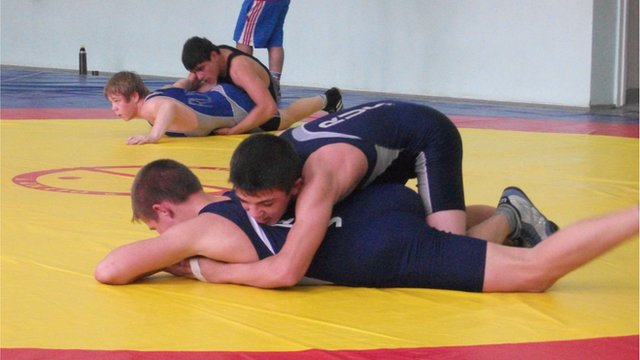 Wrestling students in training session