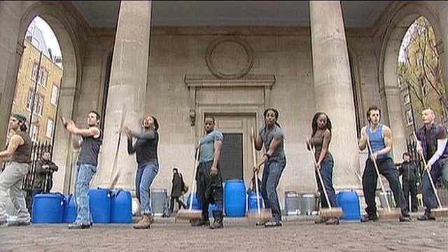 Cast members of Stomp performing in London's Covent Garden