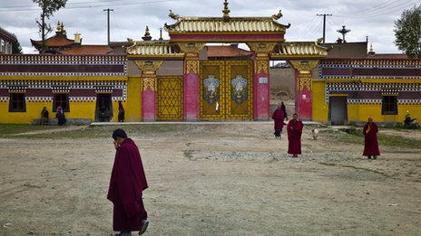 Monks outside an entrance to the Kirti monastery on 17 October 2011