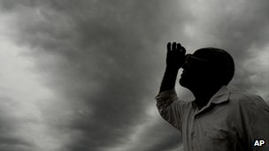 Man watching the formation of monsoon clouds (Image: AP)
